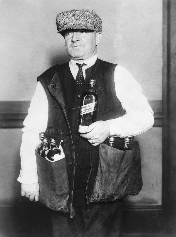 A revenue agent wearing a waistcoat designed to hide whiskey during the prohibition era in America. Photo: Topical Press Agency, Getty Images / Hulton Archive