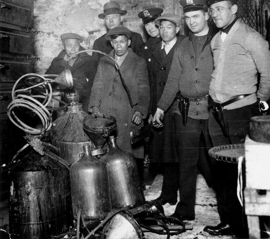 A raid on a basement, in Mulberry Street, New York, where a group of Chinese immigrants were suspected of making hooch during prohibition. Photo: Keystone, Getty Images / Hulton Archive