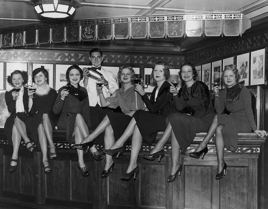 A group of young women at the bar on board the luxury liner SS Manhattan, off New York, 5th December 1933. Before the repeal of prohibition, the ship's bar was required to close 12 miles out from the US coast. Photo: FPG, Getty Images / 2008 Getty Images