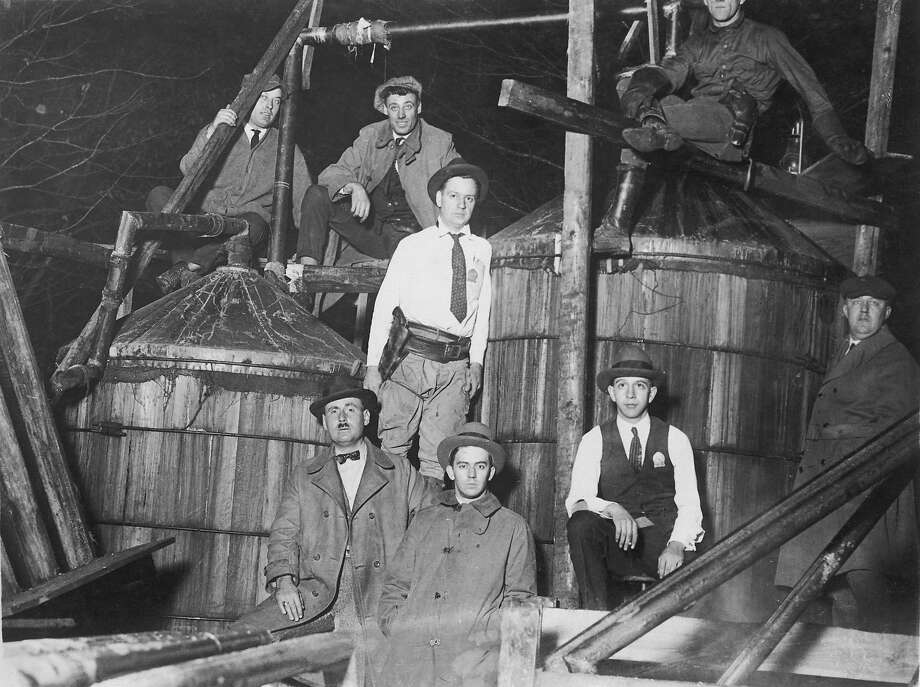 Prohibition agents with a 2000-gallon illicit still, seized near Waldorf, Maryland, circa 1925. Photo: FPG, Getty Images / 2008 Getty Images