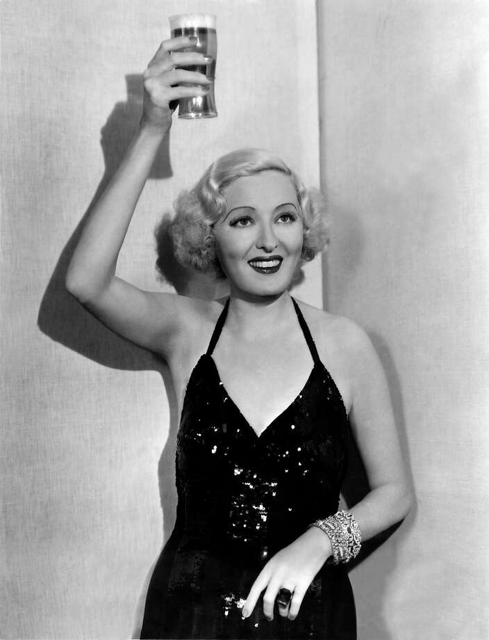 Former Ziegfeld showgirl and sometimes actress Peggy Hopkins Joyce raises a glass of beer to celebrate the end of prohibition, Hollywood. Photo: Underwood Archives, Getty Images / ©Underwood Archives