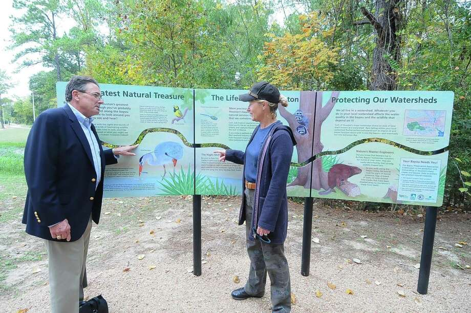 Bayou Preservation Association president Robert Rayburn and association board member Deborah Hartman discuss the new bayou educational display in Terry Hershey Park after a recent dedication ceremony. Photo: Â Tony Bullard 2013, Freelance Photographer / © Tony Bullard & the Houston Chronicle
