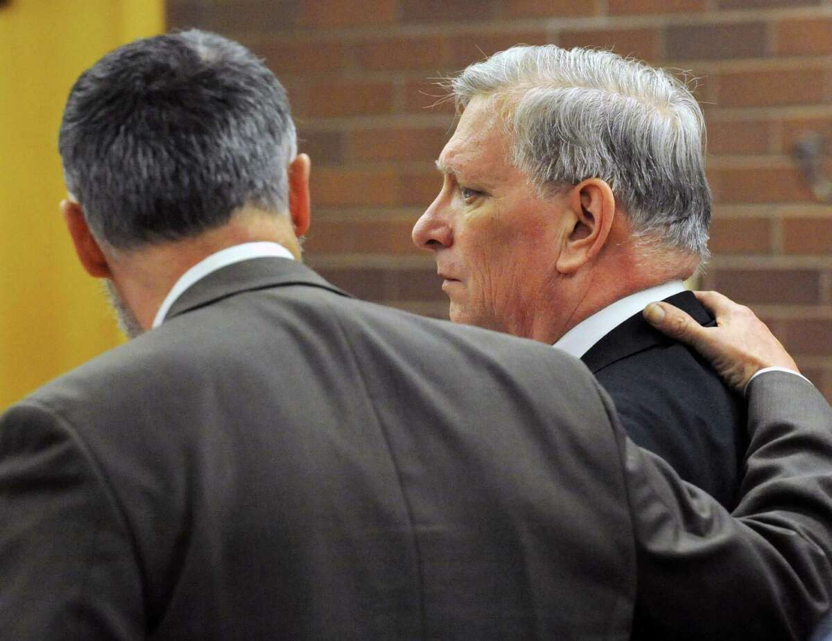 Attorney John Gulash and Robert Bell react to the reading of a not guilty verdict on manslaughter at Danbury Superior Court in Danbury, Conn. On Tuesday, Dec. 3, 2013. In a stunning reversal of fortune, a jury acquitted Robert Bell of all charges, minutes after it apppeared the had convicted him of first degree manslaughter in the December 2012 shooting of his wife.
