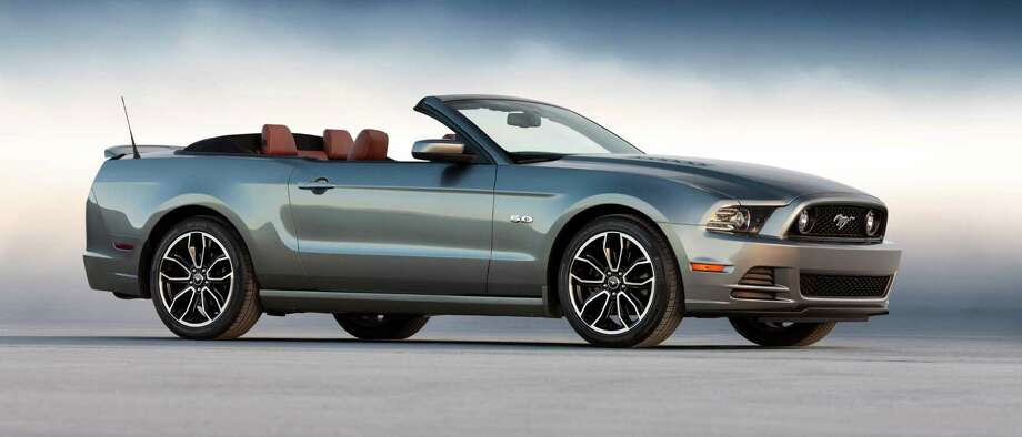 "The 2013 Mustang has a refreshed design, featuring a more-prominent grille, new hood and new LED signature lighting for a ""high-tech look.""  Standard is a SelectShift Automatic transmission, and the Mustang is offered with technology allowing drivers to monitor their own acceleration, g force and braking on the track with new 4.2-inch LCD screen showing Track Apps. Photo: Ford Motor Co., Wieck / © 2011 Ford Motor Company"
