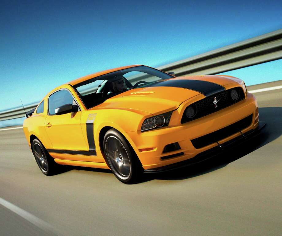 Ford's 2013 Mustang Boss 302 builds on the heritage of the 1970 Boss 302 with new, reflective hockey-stick graphics package . Also new for 2013 is heritage-inspired School Bus Yellow paint and Sterling Gray accents on the Boss Laguna Seca. Photo: Ford Motor Co. / © 2011 Ford Motor Company