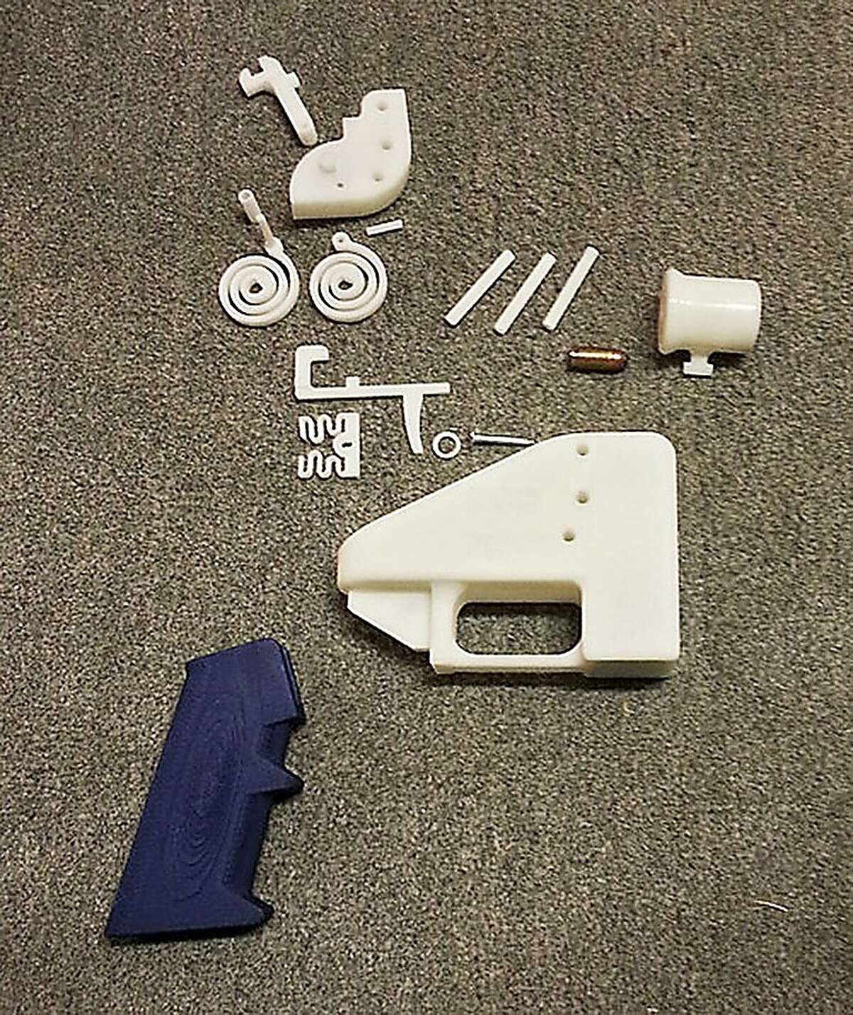 An undated handout photo of the parts of Defense Distributed's Liberator pistol, made using a 3-D printer, which the Bureau of Alcohol, Tobacco, Firearms and Explosives found capable of firing multiple .380-caliber metal bullets. Police and members of Congress fear the consequences if the Undetectable Firearms Act is not updated and renewed. (Defense Distributed via The New York Times) -- NO SALES; FOR EDITORIAL USE ONLY WITH STORY SLUGGED GUNS DETECTION POLITICS BY JEREMY W. PETERS AND MICHAEL S. SCHMIDT. ALL OTHER USE PROHIBITED.