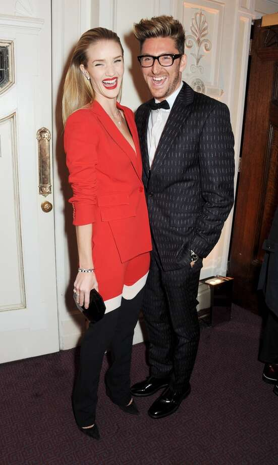 Rosie Huntington-Whitely (L) and Henry Holland attend the British Fashion Awards 2013 drinks reception at the London Coliseum on December 2, 2013 in London, England.  (Photo by David M. Benett/Getty Images) Photo: David M. Benett, Getty Images