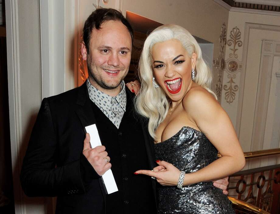 Nicholas Kirkwood (L), Accessory Designer of the Year, and Rita Ora pose at the British Fashion Awards 2013 at London Coliseum on December 2, 2013 in London, England.  (Photo by David M. Benett/Getty Images) Photo: David M. Benett, Getty Images