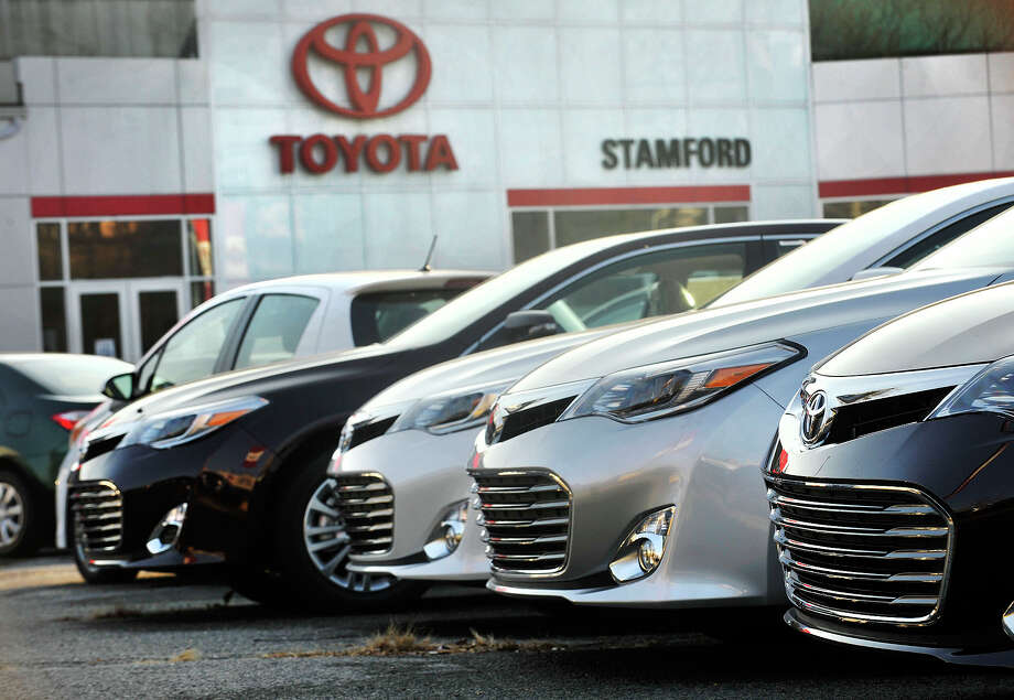 New Toyota Avalons sit in the Toyota of Stamford sales lot along Myrtle Avenue in Stamford, Conn., on Tuesday, Dec. 3, 2013. November's new auto sales numbers put Toyota up roughly 10 percent. Photo: Jason Rearick / Stamford Advocate