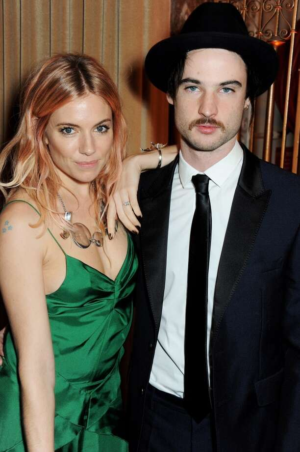 Sienna Miller (L) and Tom Sturridge attend the British Fashion Awards 2013 drinks reception at the London Coliseum on December 2, 2013 in London, England.  (Photo by David M. Benett/Getty Images) Photo: David M. Benett, Getty Images