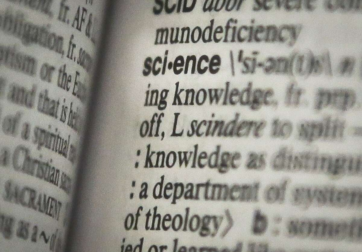 """This Monday, Dec. 2, 2013 photo shows the word """"science"""" on a page of a Merriam-Webster dictionary, in New York. """"Science"""" is the publisher's word of the year. (AP Photo/Bebeto Matthews)"""