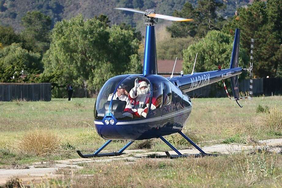 The bearded man will arrive Saturday at the Carmel Valley Airfield in a helicopter, an upgrade from his two-seater plane. The 55-year-old Santa Fly-In is a cherished valley tradition. Photo: Paul Ingram, Handout