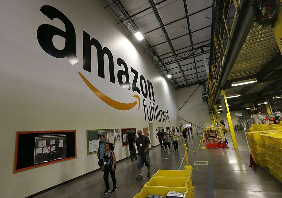 Workers fill orders Monday at an Amazon.com warehouse in Phoenix. Online sales rose 21 percent. Photo: Ross D. Franklin, Associated Press