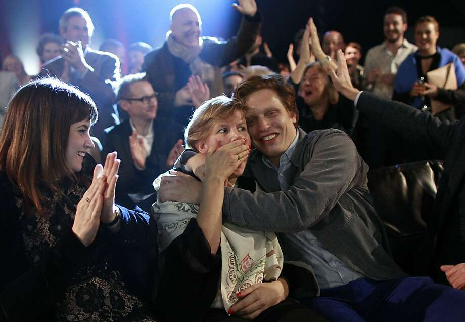 Gobsmacked:Laure Prouvost reacts as she is named the winner of the 2013 Turner Prize at a ceremony in Londonderry,   Northern Ireland. The 35-year-old filmmaker and installation artist won with a tea party-themed video   installation, beating three other finalists - popular humorist David Shrigley, British-German artist Tino   Sehgal and Lynette Yiadom-Boakye, a Londoner of Ghanaian descent. Photo: Peter Morrison, Associated Press