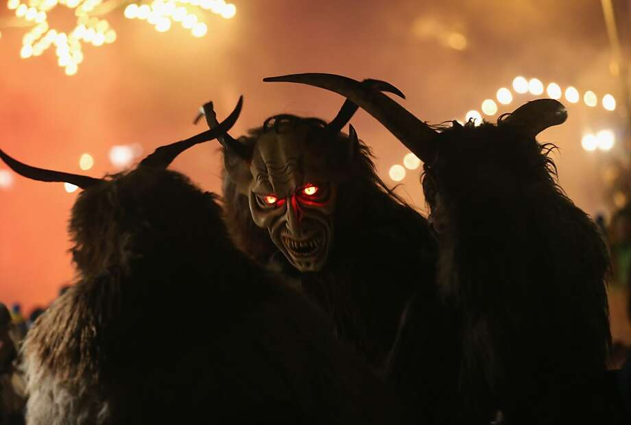 Didn't pick up your toys? We'll be knocking at your door:Demon-like Krampus creatures walk the streets in search of bad children during Krampus night in Neustift im Stubaital, Austria. Since the 17th century, Krampus traditionally has accompanied St. Nicholas and angels visiting households to reward children who have been good and reprimand those who have not. Photo: Sean Gallup, Getty Images