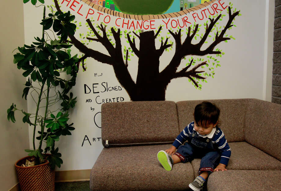 A child plays on a couch at the Hamilton Family Center in San Francisco. Photo: Brant Ward / The Chronicle / ONLINE_YES