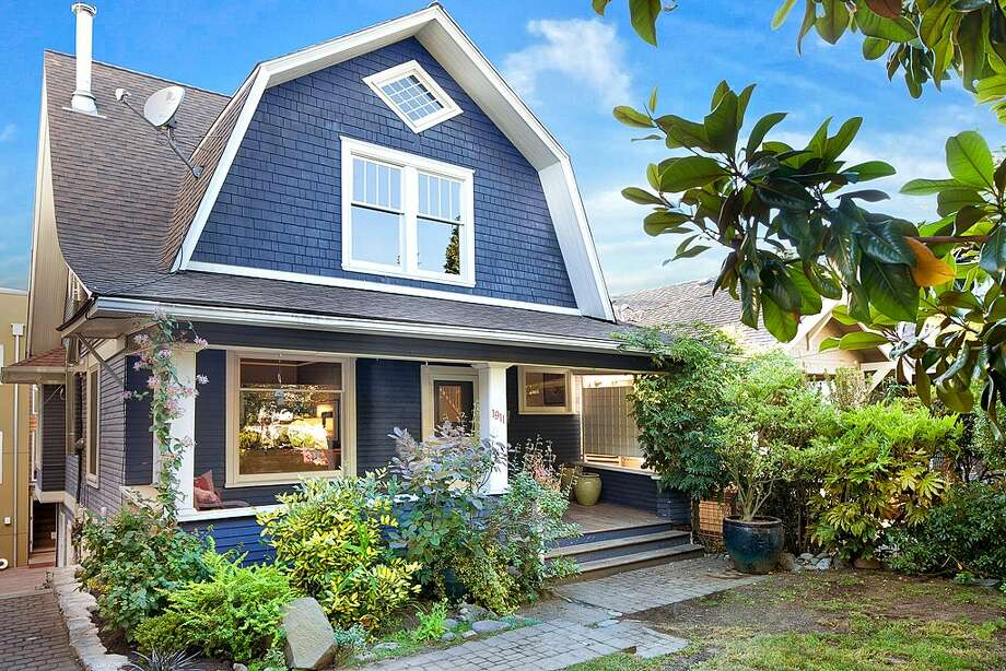 First comes 1911 9th Ave. W. The 2,160-square-foot home, built in 1907, has four bedrooms, two bathrooms, built-ins, wainscoting, two fireplaces, wood and concrete floors, a front porch and a balcony. It's listed for $599,950. Photo: Courtesy Andy Sather,  John L. Scott Real Estate