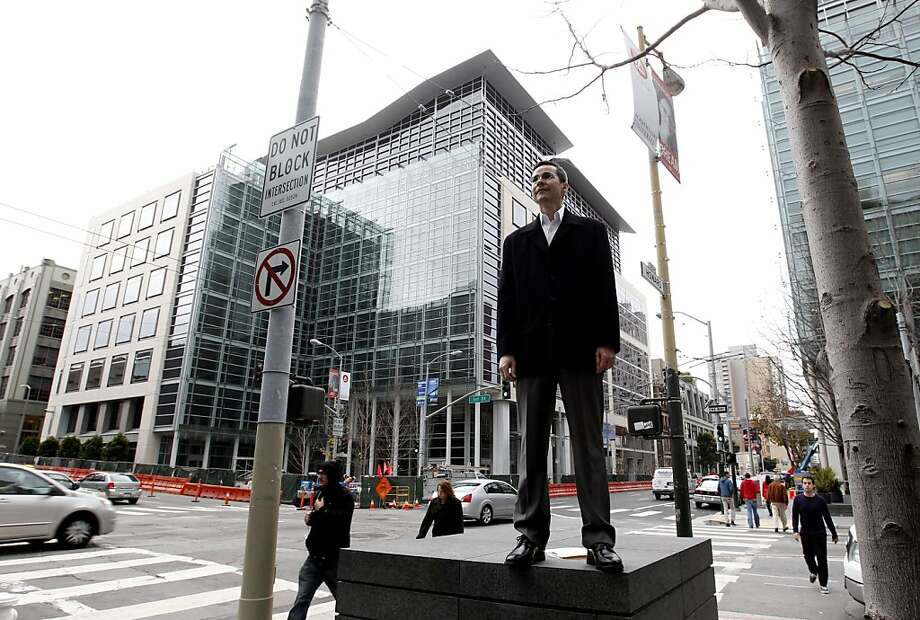 Colin Yasukochi, director of research at CBRE, stands at a corner in SoMa, the heart of the city's tech boom. Photo: Michael Macor, The Chronicle