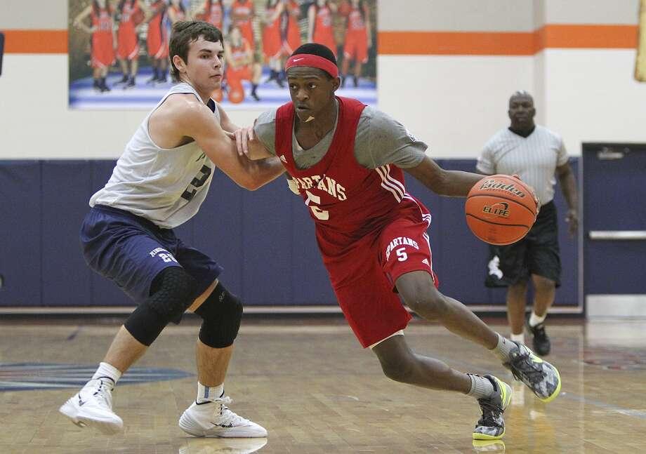 Cy Lakes sophomore guard De'Aaron Fox is a big reason the Wildcats are picked as title contenders. Photo: Diana L. Porter, Freelance / © Diana L. Porter