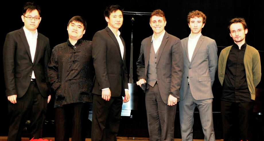 Winners of the the 2013 Heida Hermanns International Piano Competition  held in Westport are, from left:  Yi Yang Chen, Moye Chen, Andrew Yang, Joshua Wright, Samuel Post, and Timur Mustakimov. Wright and Mustakimov were the first-place winners. Photo: Contributed Photo / Westport News