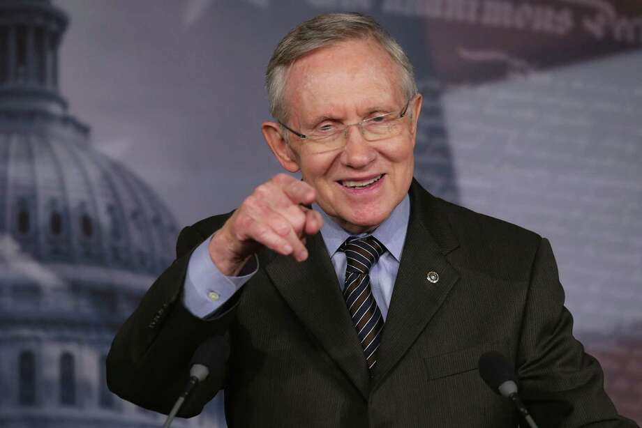 "Senate Majority Leader Harry Reid finally did something that he will be remembered for when he invoked the so-called ""nuclear option,"" voting to change Senate rules on the controversial filibuster for most presidential nominations with a simple majority vote. Photo: Chip Somodevilla / Getty Images"