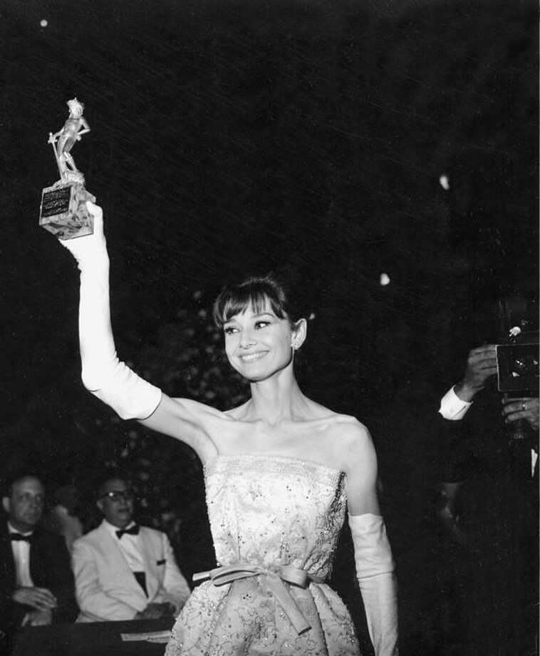 Audrey Hepburn -- about the last actress I'd call alluring -- enchanting, delightful, lovely, yes, but not alluring.  However, so man of you disagree that I have no choice.