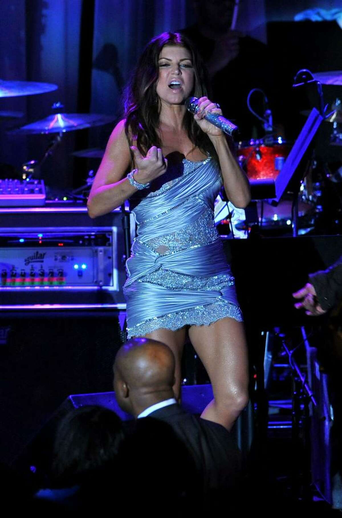 Singer Stacy Ferguson, Fergie, performs onstage at the annual Pre-GRAMMY Gala presented by The Recording Academy and Clive Davis on Saturday, Jan. 30, 2010 at The Beverly Hilton Hotel in Beverly, Hills, California. (AP Photo/Vince Bucci)
