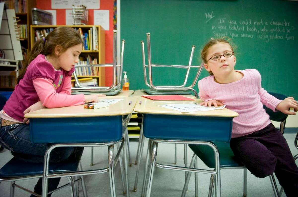 Zara Weist, left, 7, and Isabella Ranero, right, 7, study in an Italian class during the after-school language program at Newfield Elementary School in Stamford, Conn. on Wednesday, Jan. 27, 2010