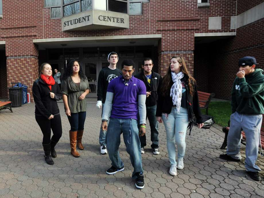 Play It By Ear (PIBE) a cappella group performed in the Western Connecticut State University Student Center Plaza on the university's Midtown campus in Danbury, Conn. on Tuesday, Dec. 3, 2013. Performimg, left to right, Casey Mersh, Amber Lebron, Andy Serven, Reuel Camacho, Joel Vega, Justine Lasky and Adam Heavens. Photo: Cathy Zuraw / The News-Times