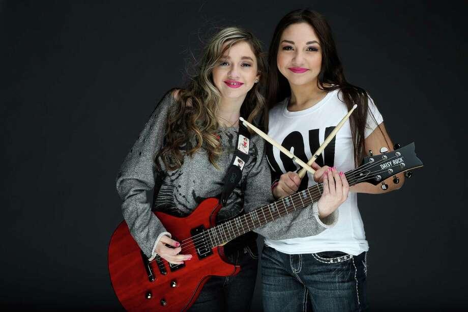 Zoe and Molly Flores of the girl band Starflightrocks Photo: Karen Warren, Staff / © 2013 Houston Chronicle