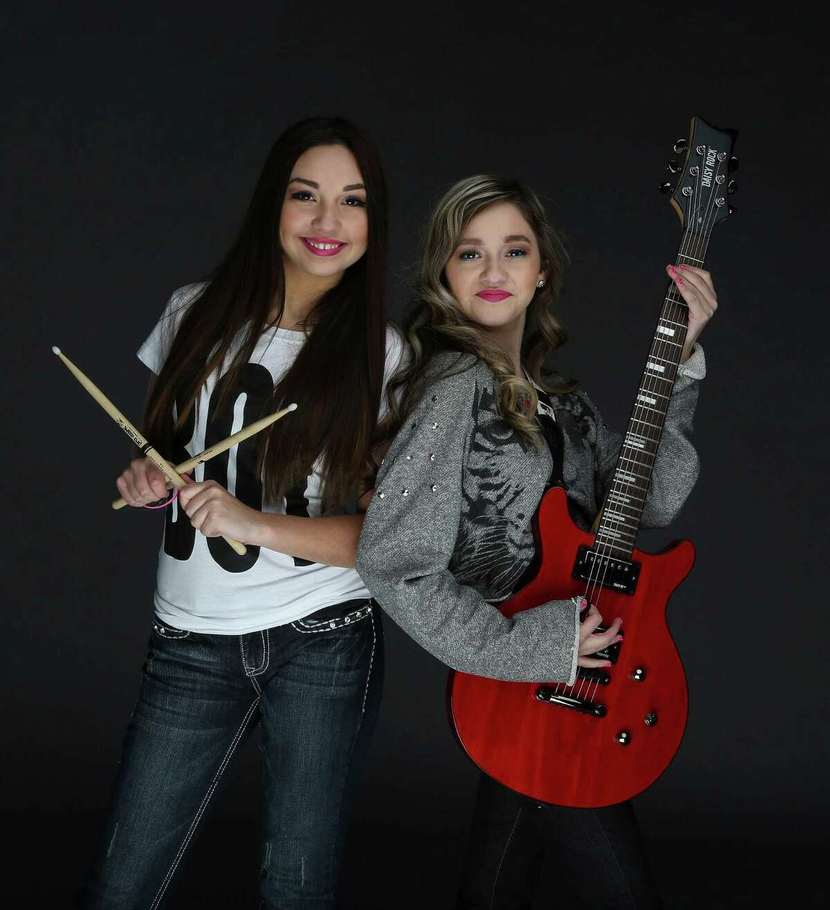 Molly and Zoe Flores of the girl-band StarFlightRocks, photographed in the Houston Chronicle studio, Wednesday, Nov. 27, 2013, in Houston. ( Karen Warren / Houston Chronicle )