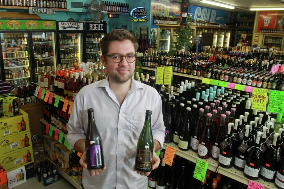 Justin Vann, wine consultant for D&Q Beer Station, recommends Jean-Pierre Robinot Petilliant-Naturel wines, Les Anneesfolles, left, and Fetembulles. Photo: Gary Fountain, Freelance / Copyright 2013 Gary Fountain.
