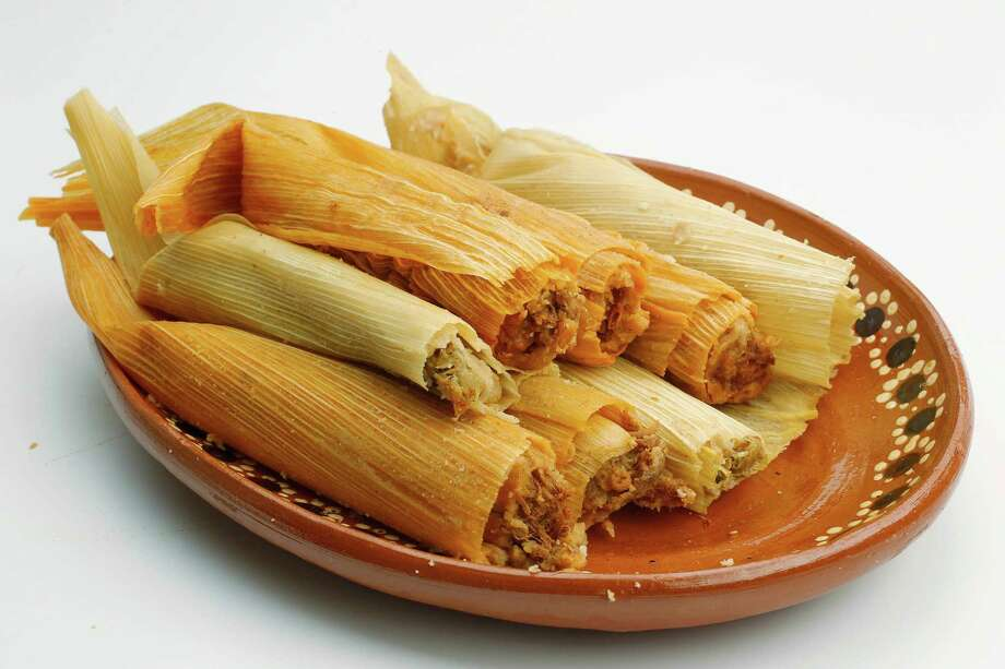 Tamales are a holiday favorite here in Texas. (Who are we kidding? It's a favorite any time of year!) One of these guys will set you back a whopping 284 calories on average. Photo: Mayra Beltran, Staff / © 2011 Houston Chronicle
