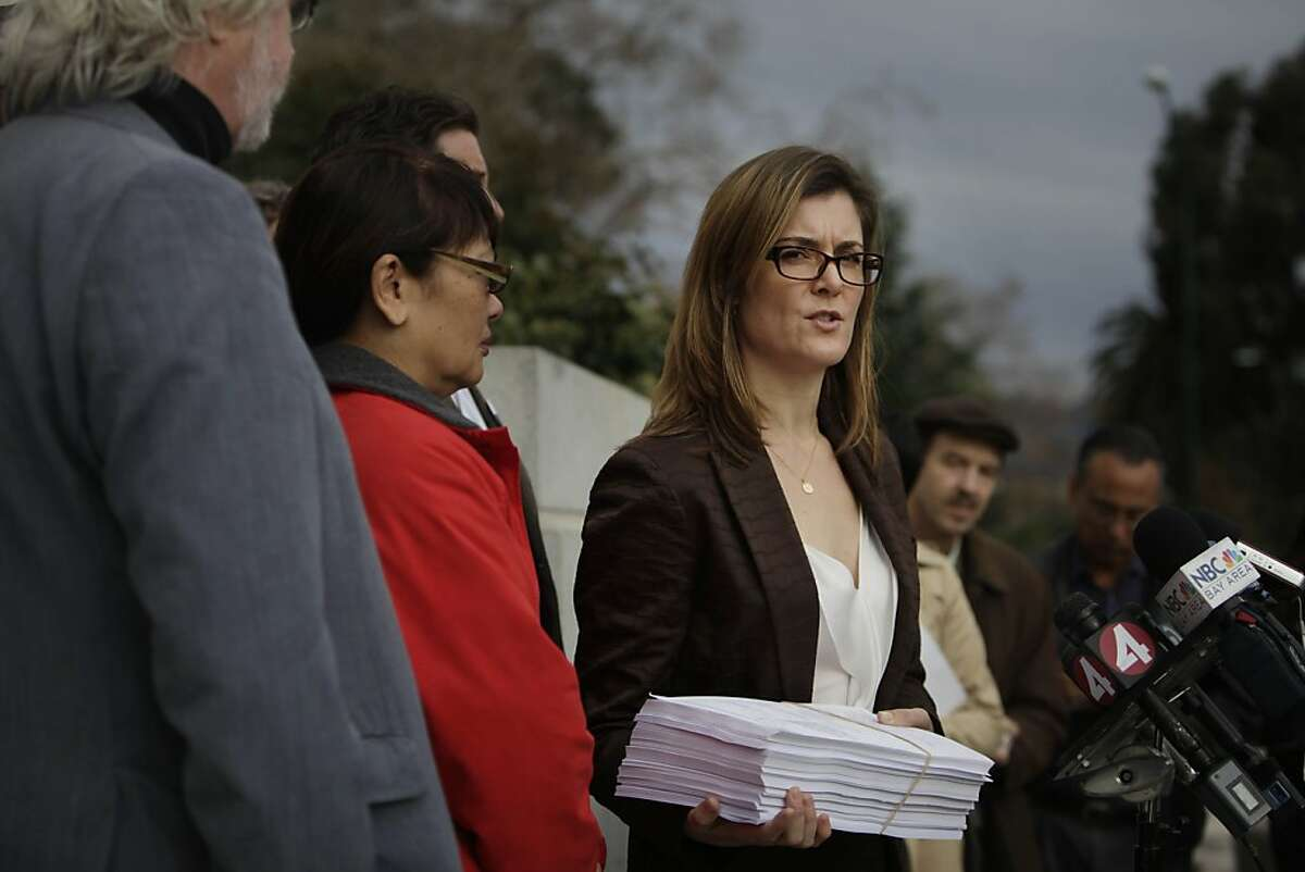 Kerianne Steele (right), attorney for SEIU 1021, speaks during a press conference announcing the filing of a lawsuit against the BART board of directors over a contract dispute outside the Rene C. Davidson Courthouse on Tuesday, December 3, 2013 in Oakland, Calif.