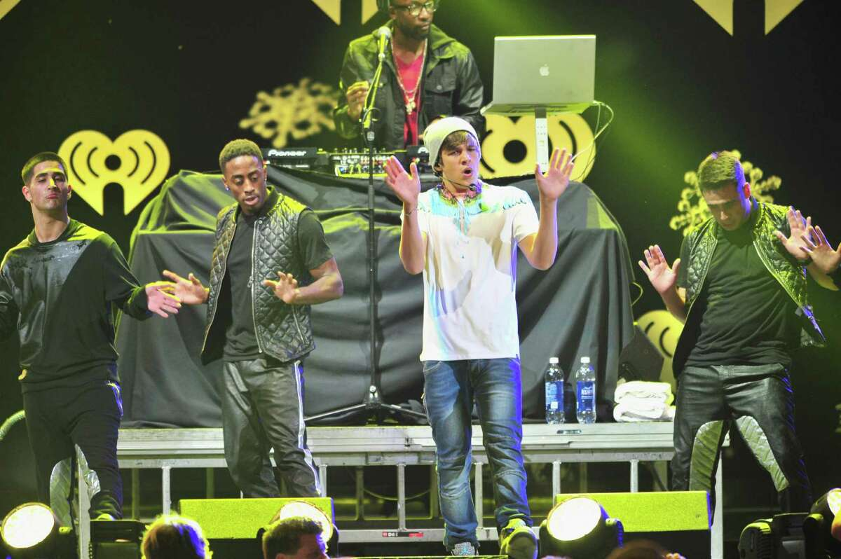 DALLAS, TX - DECEMBER 02: Recording artist Austin Mahone performs onstage during 106.1 KISS FM's Jingle Ball 2013 at American Airlines Center on December 2, 2013 in Dallas, Texas.