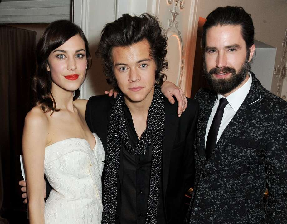 Harry Styles (C), winner of the British Style Award, poses with presenters Alexa Chung and Jack Guinness at the British Fashion Awards 2013 at London Coliseum on December 2, 2013 in London, England.  (Photo by David M. Benett/Getty Images) Photo: David M. Benett, Getty Images