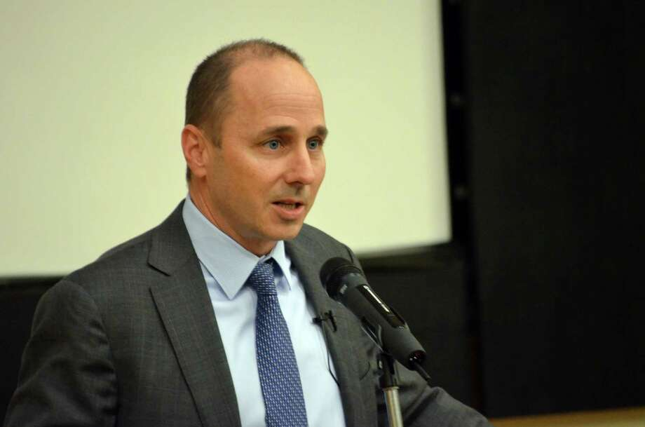 Brian Cashman, New York Yankees general manager and senior vice president, spoke about civility in baseball at the Stamford Public Library on Monday, Dec. 2. Photo: Megan Spicer / Darien News