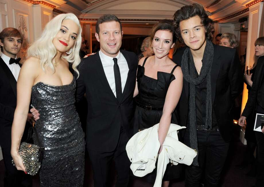 (L to R) Rita Ora, Dermot O'Leary, Dee Koppang and Harry Styles attend the British Fashion Awards 2013 drinks reception at the London Coliseum on December 2, 2013 in London, England.  (Photo by David M. Benett/Getty Images) Photo: David M. Benett, Getty Images