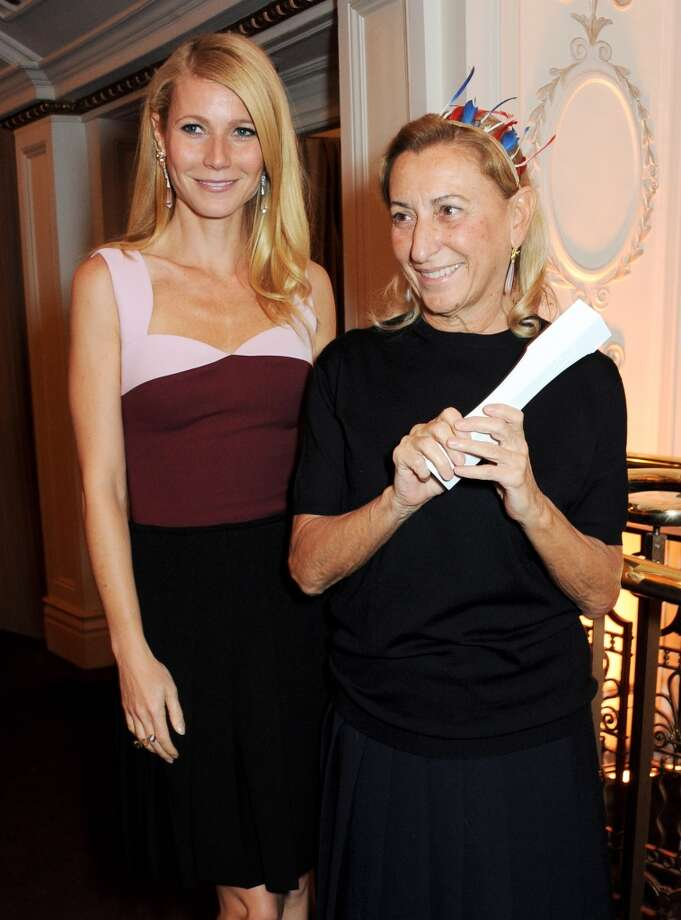 Presenter Gwyneth Paltrow (L) and Miuccia Prada, winner of the International Designer of the Year, pose at the British Fashion Awards 2013 at London Coliseum on December 2, 2013 in London, England.  (Photo by David M. Benett/Getty Images) Photo: David M. Benett, Getty Images