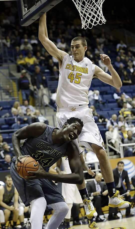 UC Irvine's Mamadou Ndiaye (34) positions himself for a layup next to California 's David Kravish (45) during the second half on an NCAA college basketball game on Monday, Dec. 2, 2013, in Berkeley, Calif. (AP Photo/Marcio Jose Sanchez) Photo: Marcio Jose Sanchez, Associated Press
