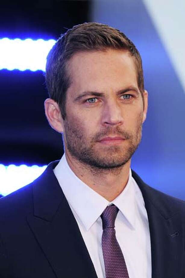 Actor Paul Walker's death is definitely ironic: a man known for his role as a street racer in 'The Fast and the Furious' ends up dying in a car wreck.  Photo: Eamonn McCormack, WireImage / 2013 Eamonn McCormack