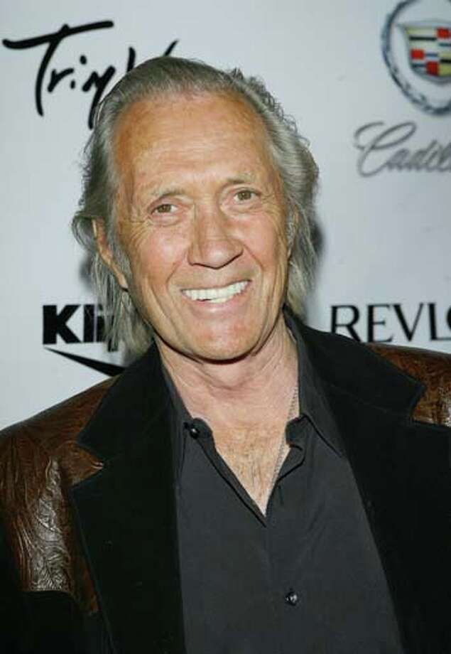 David Carradine in Bangkok, Thailand in 2009. The general consensus is that he died from auto-erotic asphyxiation after he was found dead by a hotel maid, slumped over naked in a closet with cords around his neck and his genitals. Photo: M. Tran, FilmMagic / FilmMagic