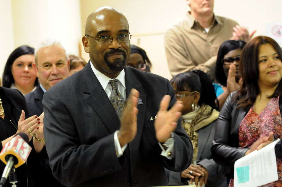 Quintin Bullock, president of Schenectady County Community College, center, applauds during a news conference on March 6, 2013, at the State Labor Department in Albany. Bullock will be leaving to head a Pennsylvana community college.  (Cindy Schultz / Times Union)