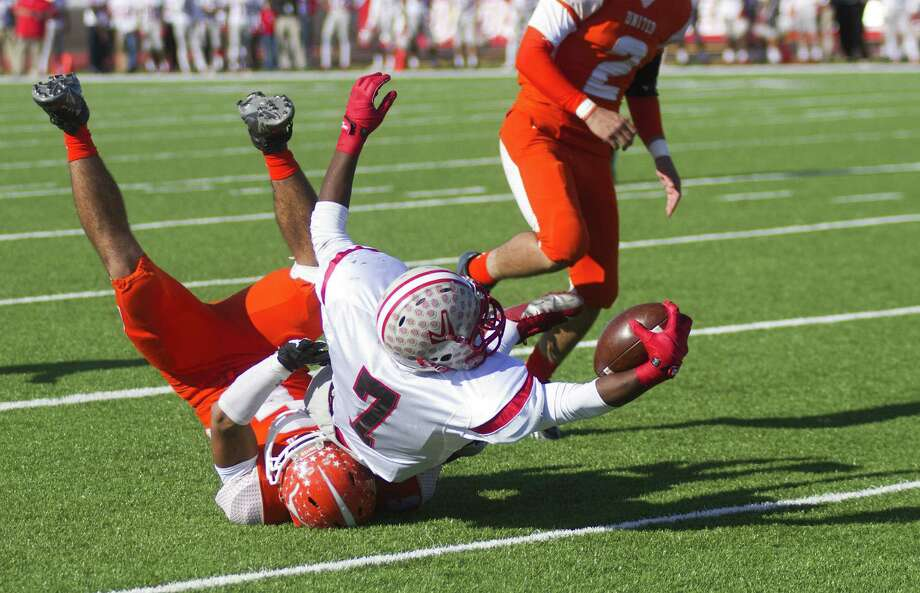 Jo'Von Kyle stretches across the goal line to score on a 4-yard run in the first quarter Friday at Cabaniss Field in Corpus Christi. Kyle ran five times for three touchdowns as Judson beat Laredo United 68-21. Photo: Jason Mack / Laredo Morning Times