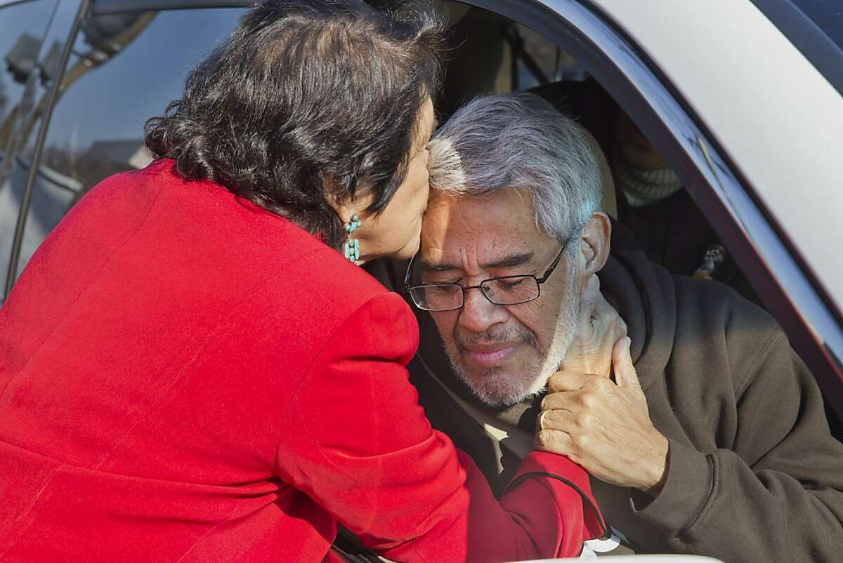 Dolores Huerta, left, a civil rights activist who co-founded the National Farmworkers Association with César Chávez, kisses Eliseo Medina on his forehead as he is taken for medical attention after fasting for 22-days in support of comprehensive immigration reform as part of