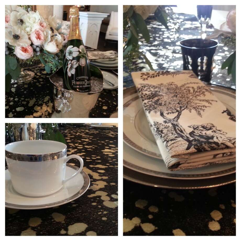 Black Christofle stemware and toile are paired with a gold-specked hide at Randall Edward Design.