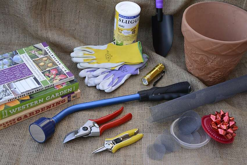 Books, small tools, Atlas garden gloves, Sluggo (and a flashlight), pots and small rounds cut from fiberglass window screen are helpful gifts for starting a container garden.