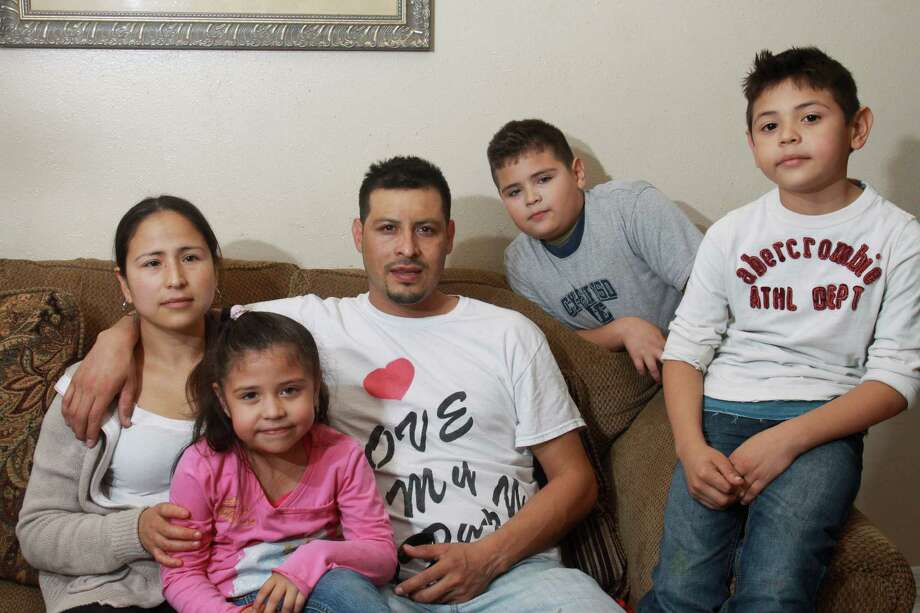 Mariela and Jesus Cruz with their children, Debanhi, 4, Jesus Daniel, 9, and Adalberto, 7. Photo: Gary Fountain, Freelance / Copyright 2013 Gary Fountain.