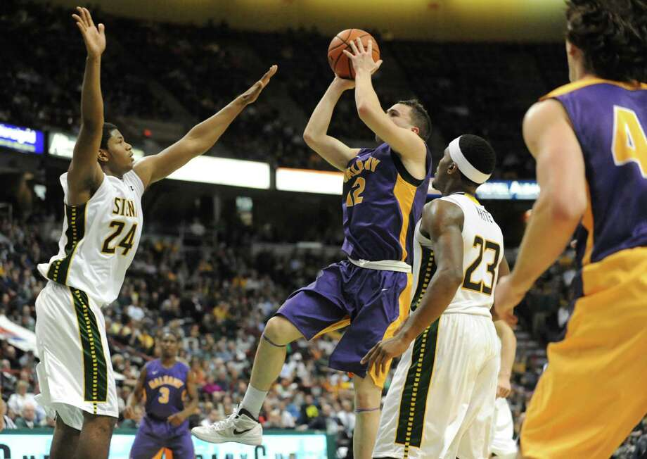 Guarded by Siena's Lavon Long, UAlbany's Peter Hooley takes a shot during a basketball game at the Times Union Center  Friday, Nov. 8, 2013 in Albany, N.Y. (Lori Van Buren / Times Union) Photo: Lori Van Buren / 00024543A