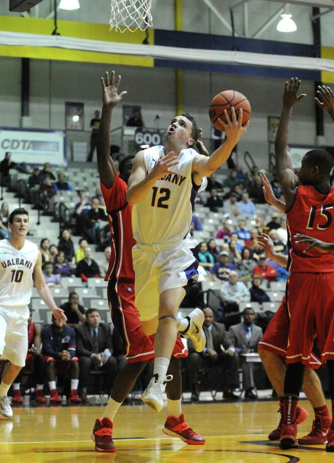 UAlbany's Peter Hooley goes to the basket during their men's college basketball game against NJIT at SEFCU arena on Tuesday Nov. 12, 2013 in Albany, N.Y.(Michael P. Farrell/Times Union) Photo: Michael P. Farrell / 00024601A
